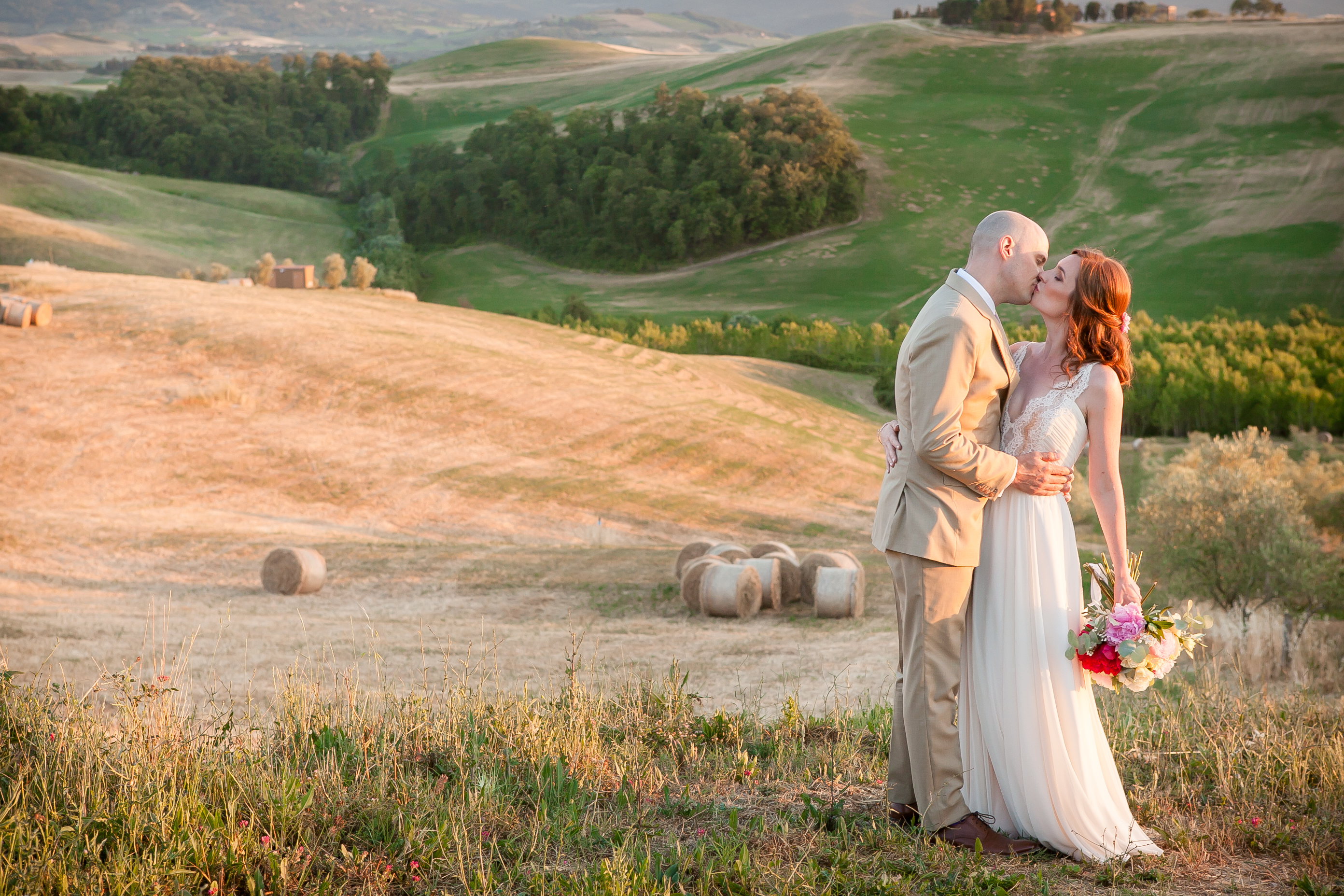 Bride & Groom kiss - Countryside Wedding in Tuscany