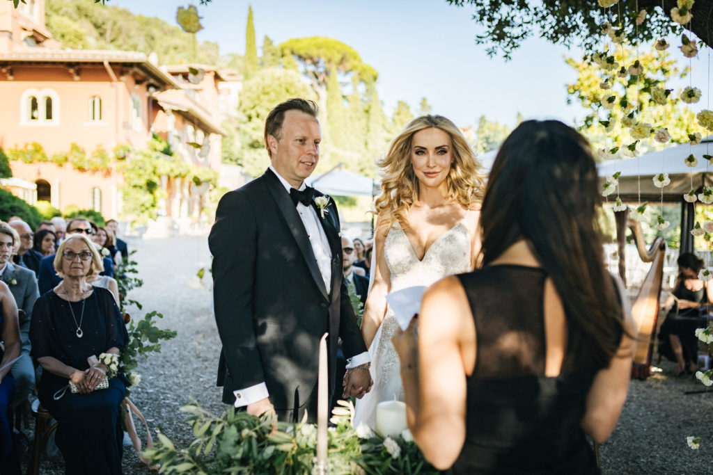 Bride & Groom during ceremony - Wedding at Villa Le Fontanelle - Italian Wedding Designer