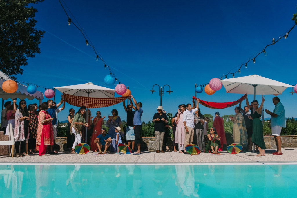 Haldi Cermeony in the swimming pool area - Indian Wedding in Tuscany - Italian Wedding Designer