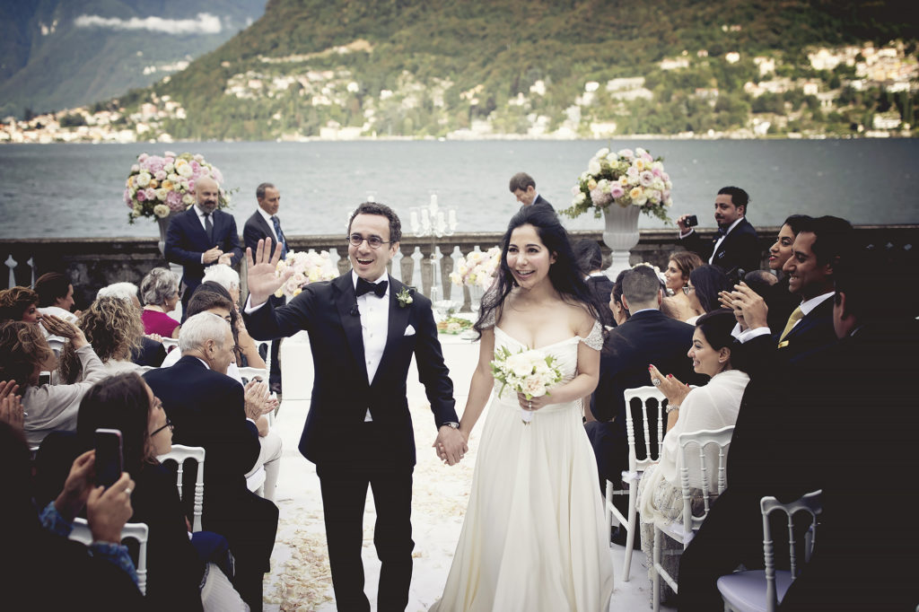 Bride and groom exit A Persian Wedding in Italy - Italian Wedding Designer