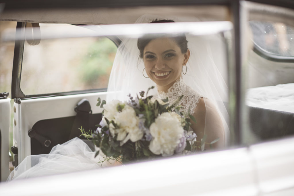 Bride in the car - Wedding at Castello di Meleto - Italian Wedding Designer