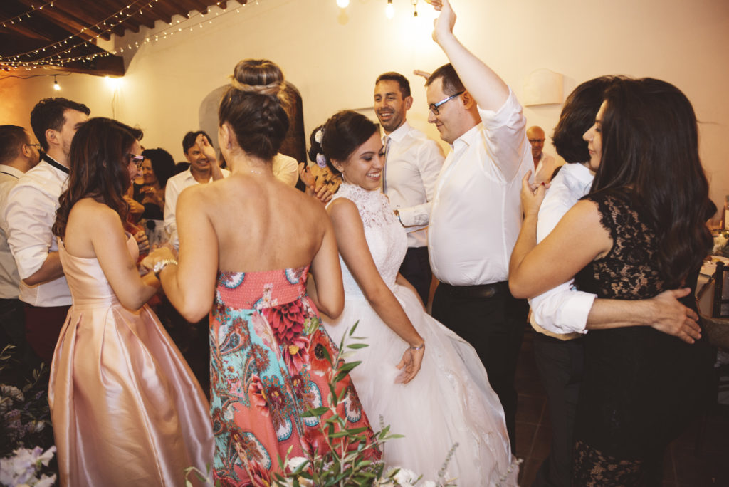 Dancing during dinner - Wedding at Castello di Meleto - Italian Wedding Designer